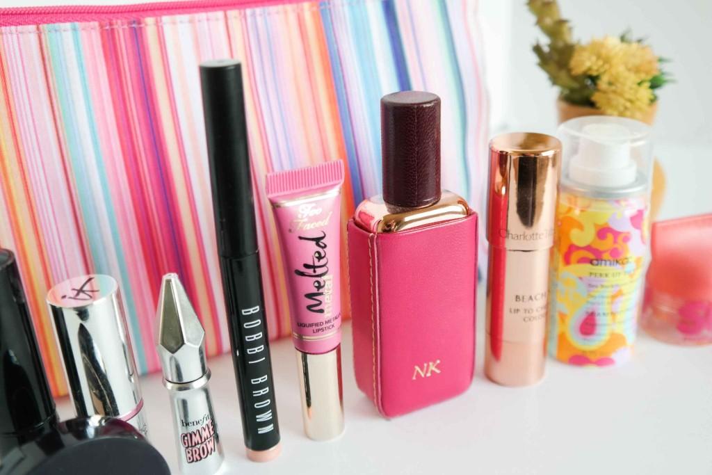 I never leave home without concelar, lipgloss, perfume and dry shampoo
