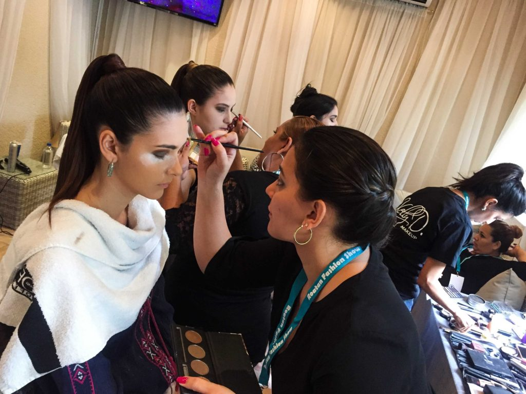The models backstage getting their make-up done for The Roatan Fashion Show 2016